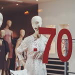 The mannequin in a retail store and a discount of seventy percent that will help in the increase of retail sales.