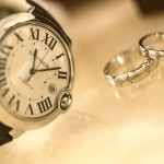 A watch and two marriage rings.