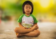 A child doing meditation.