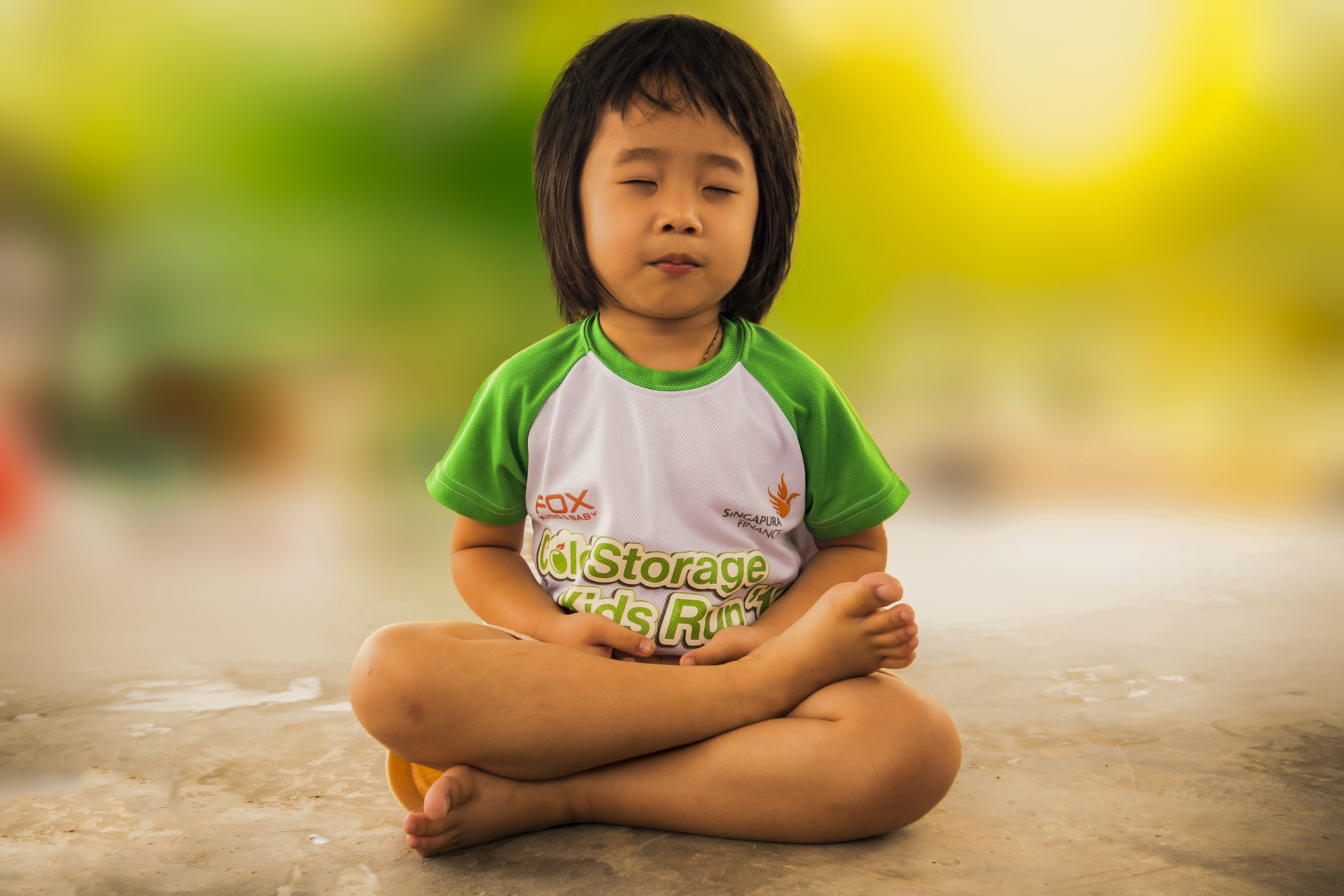 A child doing meditation.